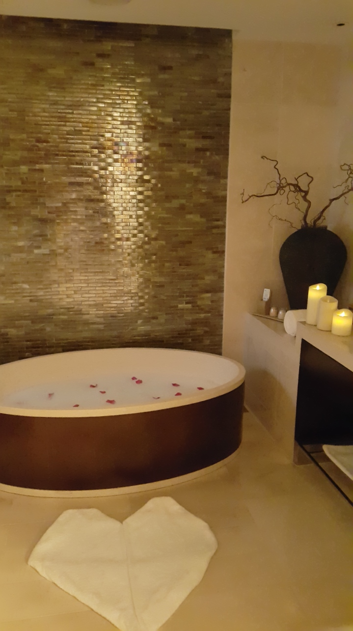 With a dash of rose petals, bubbles, salts, and scent. Then add romantic electronic candles, plus a heart-shaped rug. Voila! We have a romanntic bathtub set-up.